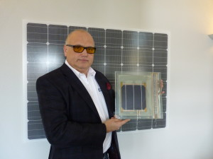 Alfred Jost showing new solar cell prototype